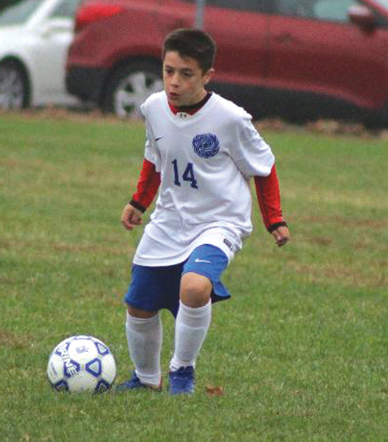 UP THE FIELD: Vets' Gabe Holland dribbles the ball up the field.