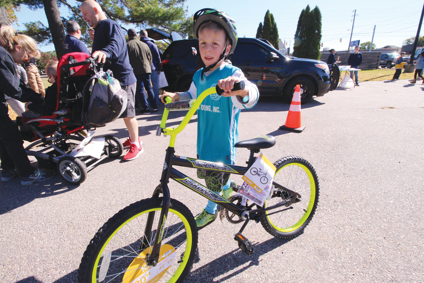 WHEELING: Austin D'Antonio, son of Warwick firefighter Joseph D'Antonio tries out one of several bikes raffled off during the open house.