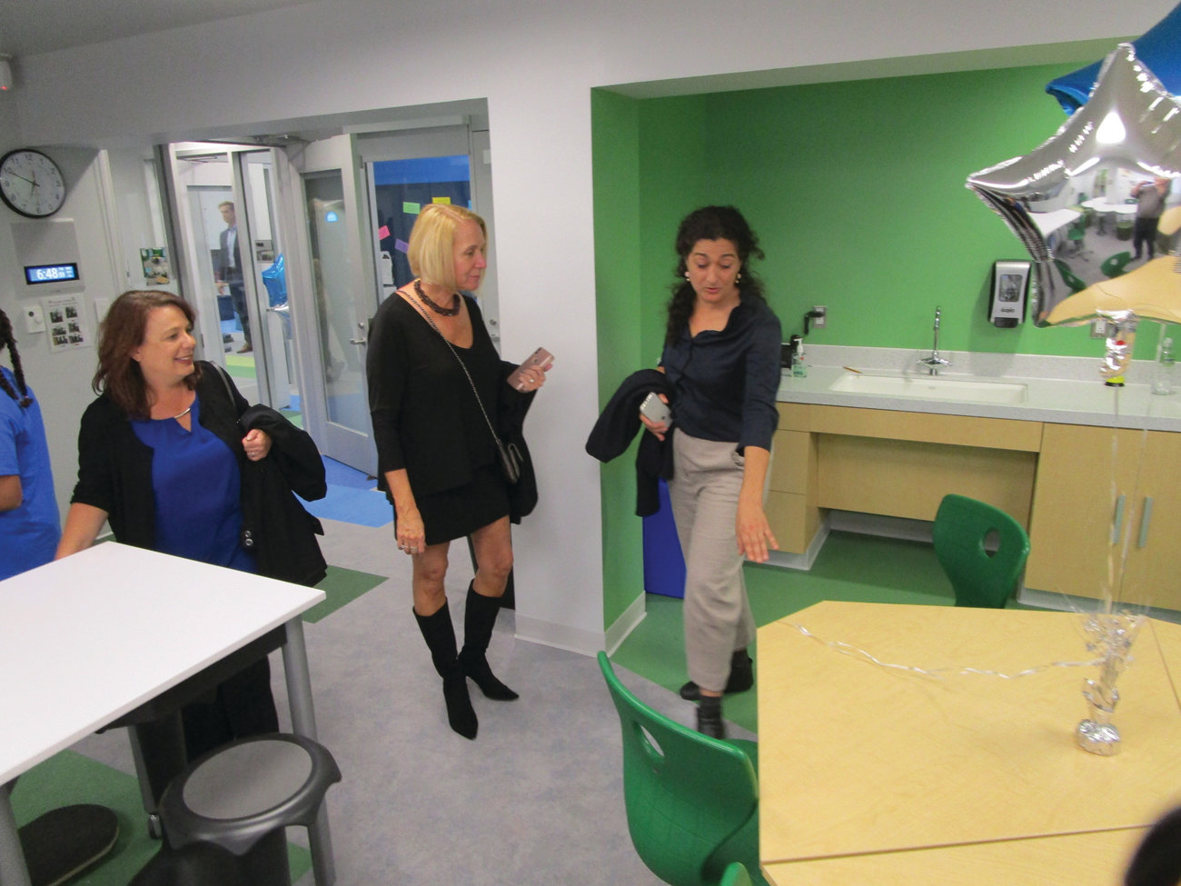 SHARING THE VISION: Avigail Milder of Philadelphia-based Milder Office Inc., right, speaks with School Committee member Janice Ruggieri, left, and state Sen. Hanna Gallo about some of the furniture her company created for the renovated wing at Eden Park.
