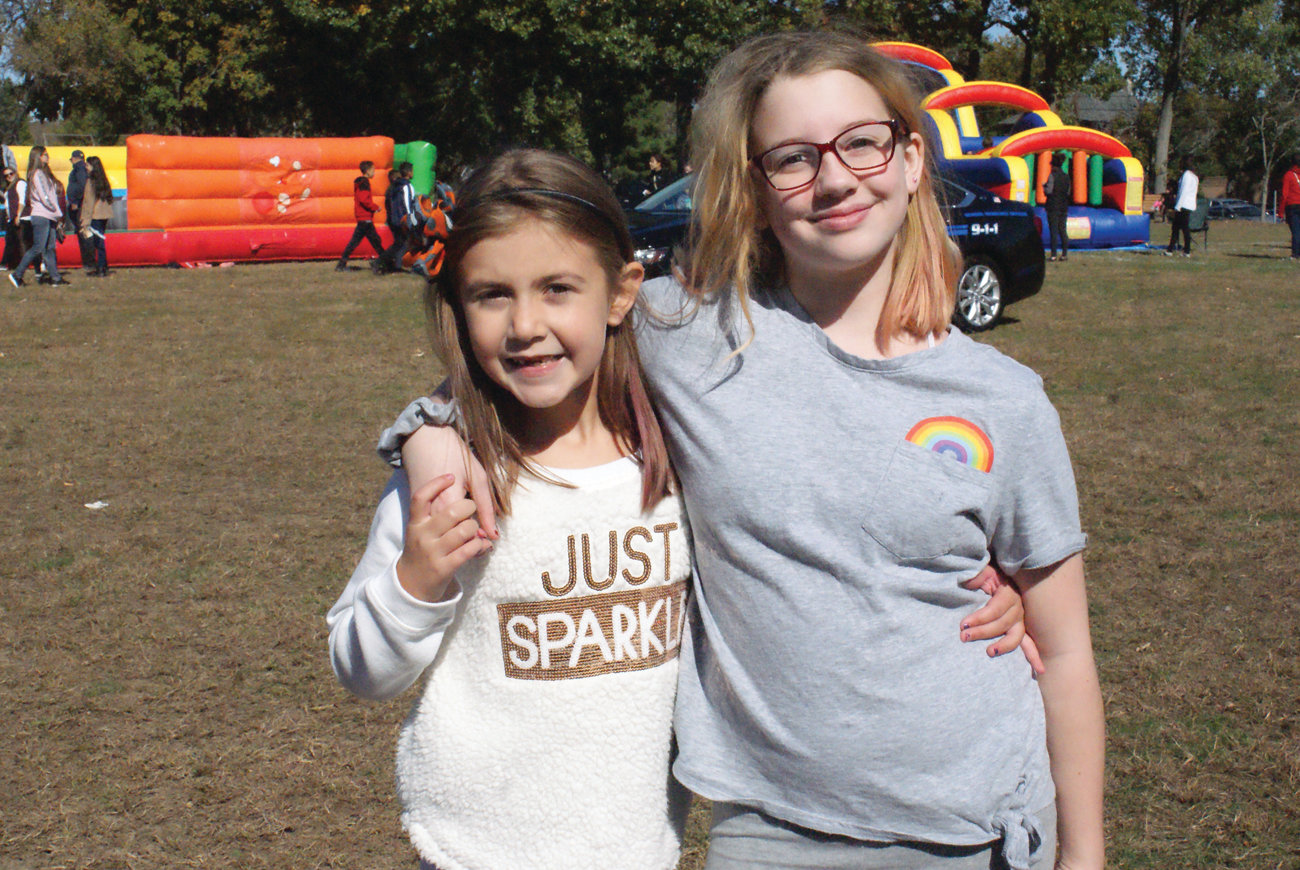 BEST FRIENDS: Enjoying the Harvest Fest at Bain Middle School this past Saturday were friends Audrey Shotter, 6, and Samantha Handrich, 11.