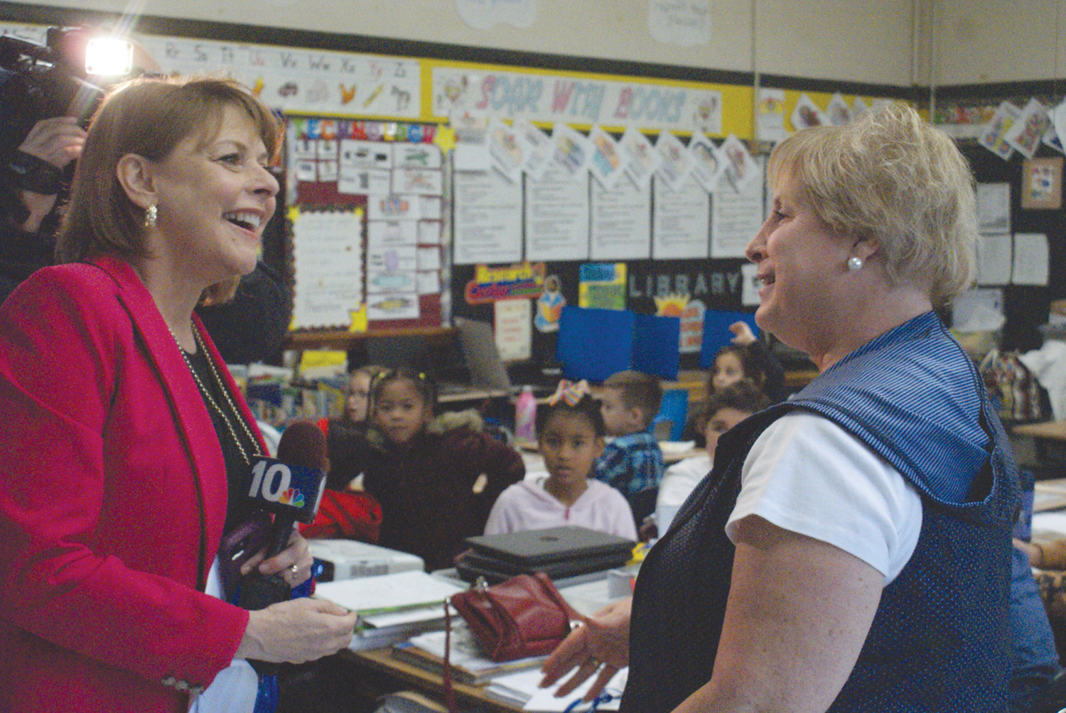 A BIG SURPRISE: WJAR's Patrice Wood surprised Judy Maurano with the Golden Apple Award on Oct. 11. The segment will be aired on NBC10 on Oct. 24 during the 6 p.m. newscast.