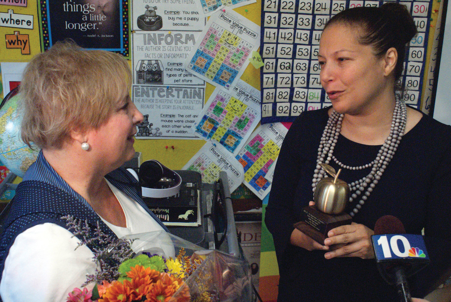 THE PRESENTATION: RIDE Commissioner Angelica Infante-Green presented Maurano with the Golden Apple Award.