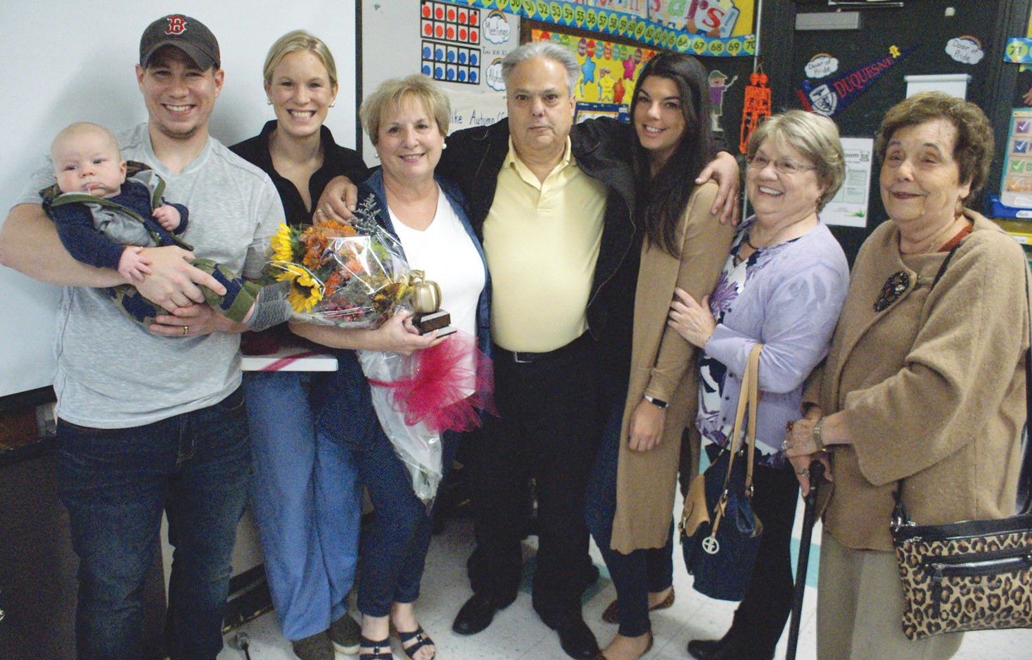FAMILY MATTERS: After receiving the Golden Apple Award, Judy Maurano posed for a photograph with family members who surprised her during the award ceremony.