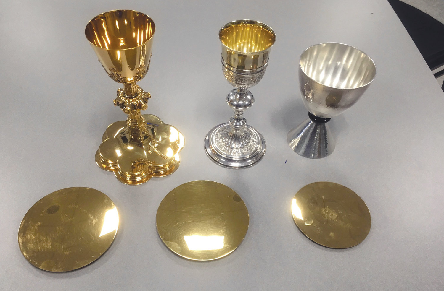 SAFE AND SECURE: These are three of the chalices recovered by the Johnston Police Department following the Oct. 22 theft at St. Rocco's Church. One chalice had been pieced out. The estimated combined value of the chalices was about $10,000.
