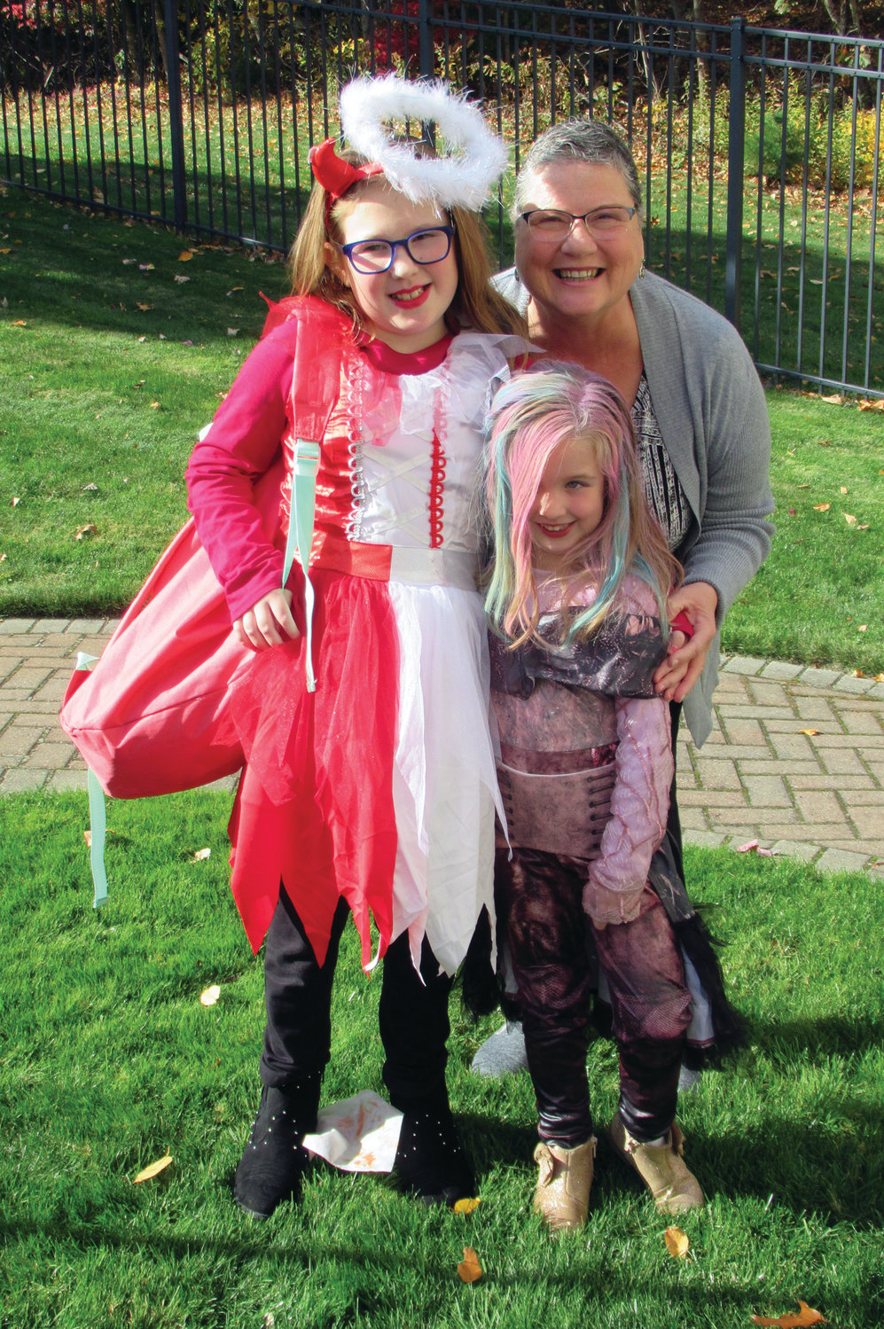 FAMILY FUN: Above, Carol March brought her grandchildren Morgan Harris and Liv Rose to Briarcliffe Manor Saturday so they could show off their classic costumes to their great-grandfather, Vinny DiDinato.