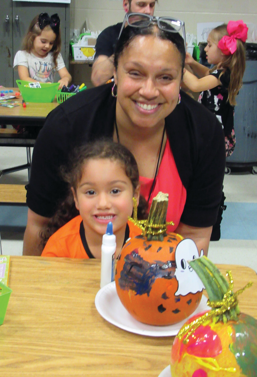 PROUD PARENT: Nicole Pope is all smiles as her daughter Isabella Rodriguez shows off her pumpkin painting during last week's annual event at the Early Childhood Center.