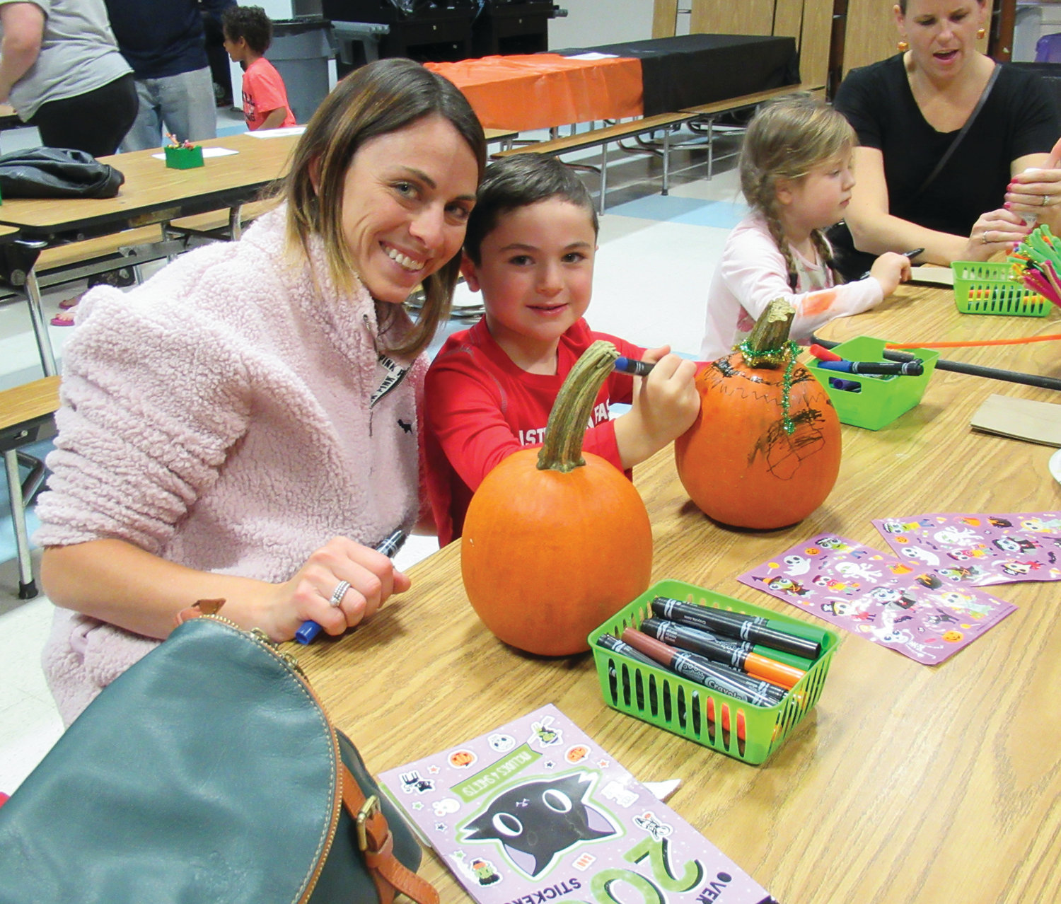 CAM'S CORNER: ECC student Cameron D'Elia, 4, and his mother, Jennifer D'Elia, display their joy while painting a pumpkin inside Ferri Middle School's cafeteria last Wednesday night.