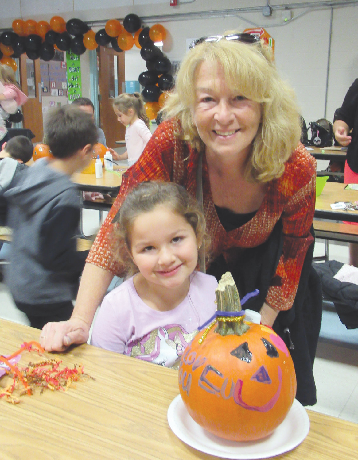 HAVING FUN: Lillyana Matarese and Cindy Matarese had on their happy faces during the ECC's annual Pumpkin Painting Night.