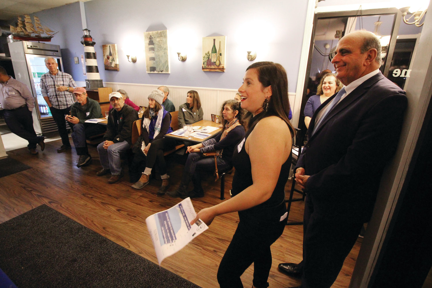 SUCCESS AT SHORELINE: Realtor Meg Mut addresses the crowd gathered for Conimicut's Business Open House last Wednesday at Shoreline Pizza, alongside Mayor Joseph Solomon.