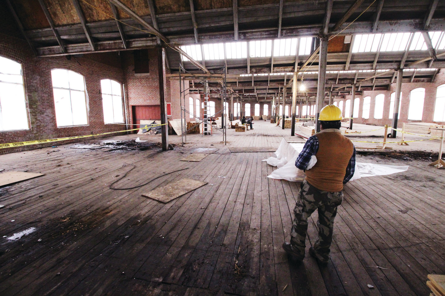 LOTS OF LIGHT: AAA plans to keep the open feature of the former mill. Crews are starting to replace sections of flooring on the second floor.