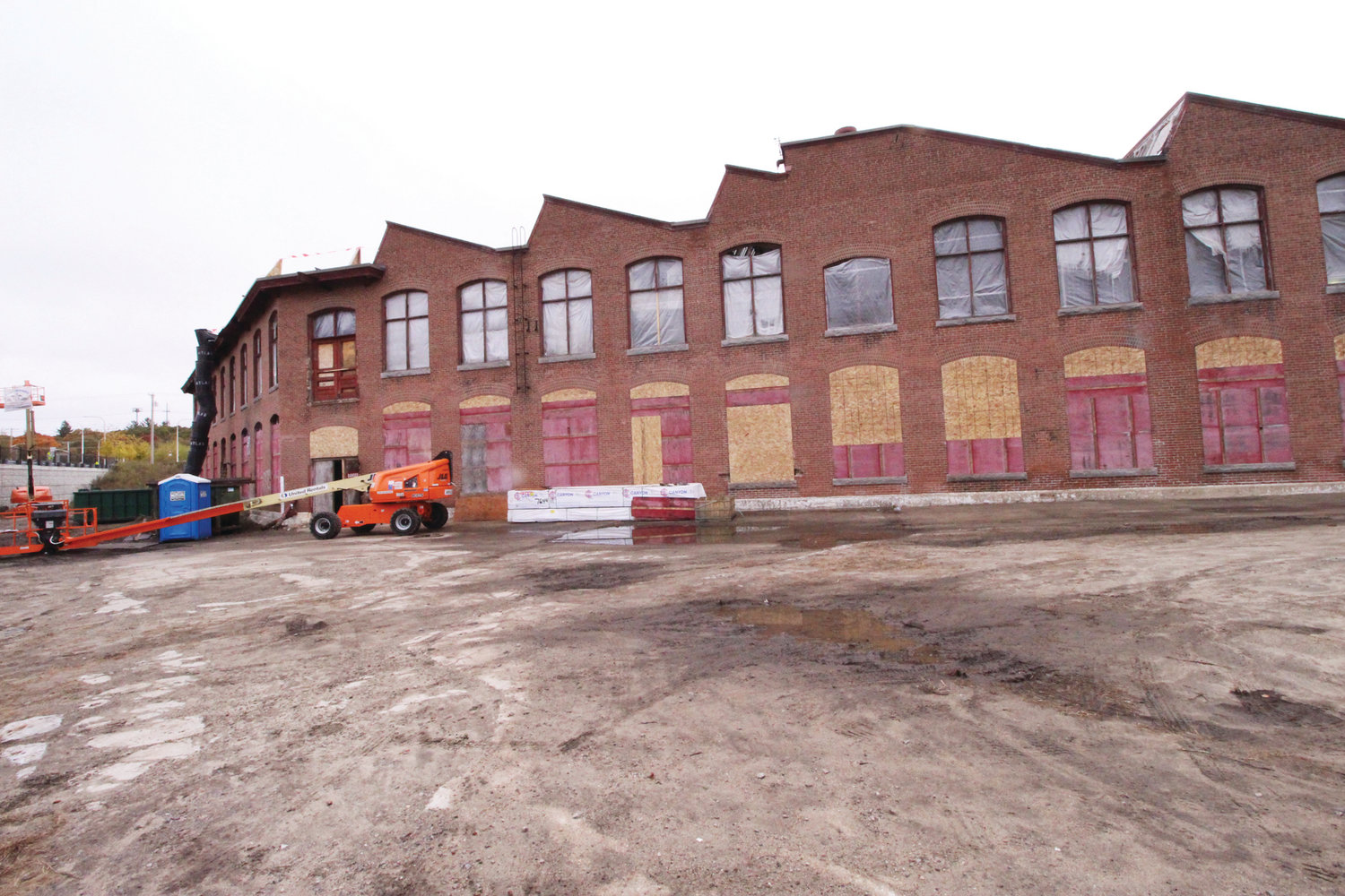 The exterior of the historic Sawtooth Building, with a unique appearance that was first constructed in 1905, and served as part of the Apponaug Mills. It is being transitioned into the modern service headquarters for AAA Northeast. It will be opening in the fall of 2020.