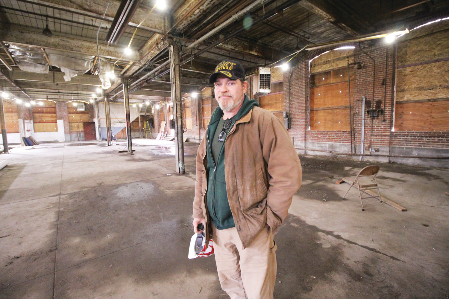 GOOD BONES: James Switzer, foreman for Case Construction, says the saw tooth building was carefully built and maintains its integrity.