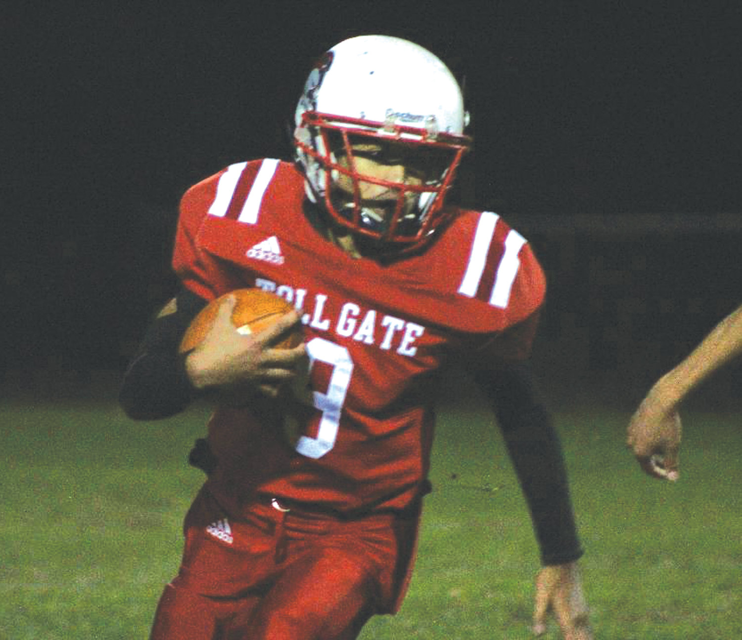GETTING THE WIN: Toll Gate's Elijah Jhaden Aguilar picks up some yards in the fourth quarter of Toll Gate's victory over Davies last week at Vets.