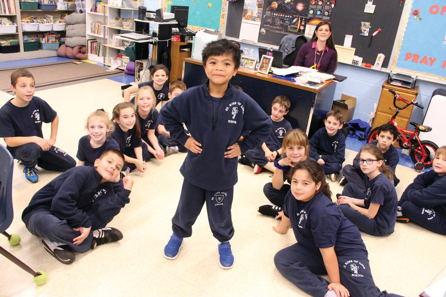 BIG ROLE FOR A 3rd GRADER: Honesto Aguinaldo takes center stage in front of his classmates at St. Rose of Lima School. He is playing the role of Tiny Tim in Trinity Rep's production of A Christmas Carol.