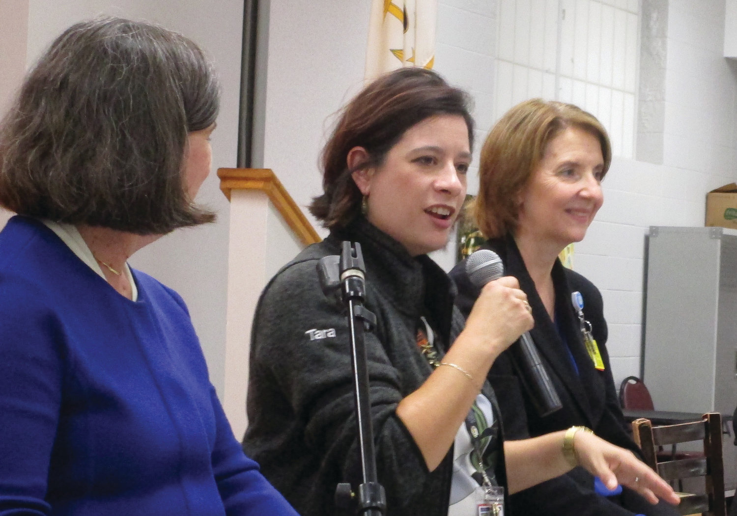 MESSAGE OF HOPE: Tara Tang, outreach coordinator for Butler Hospital's Memory & Aging Program, speaks during last week's panel discussion at the Cranston Enrichment Center. Looking on are Catherine Taylor, left, and Terry Fogerty, right.