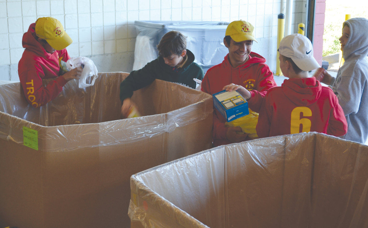 GIVING BACK: Scouts from Cranston Troops 6 and 66 were among those taking part in the collection at the Rhode Island Community Food Bank on Saturday as part of the Scouting for Food drive.