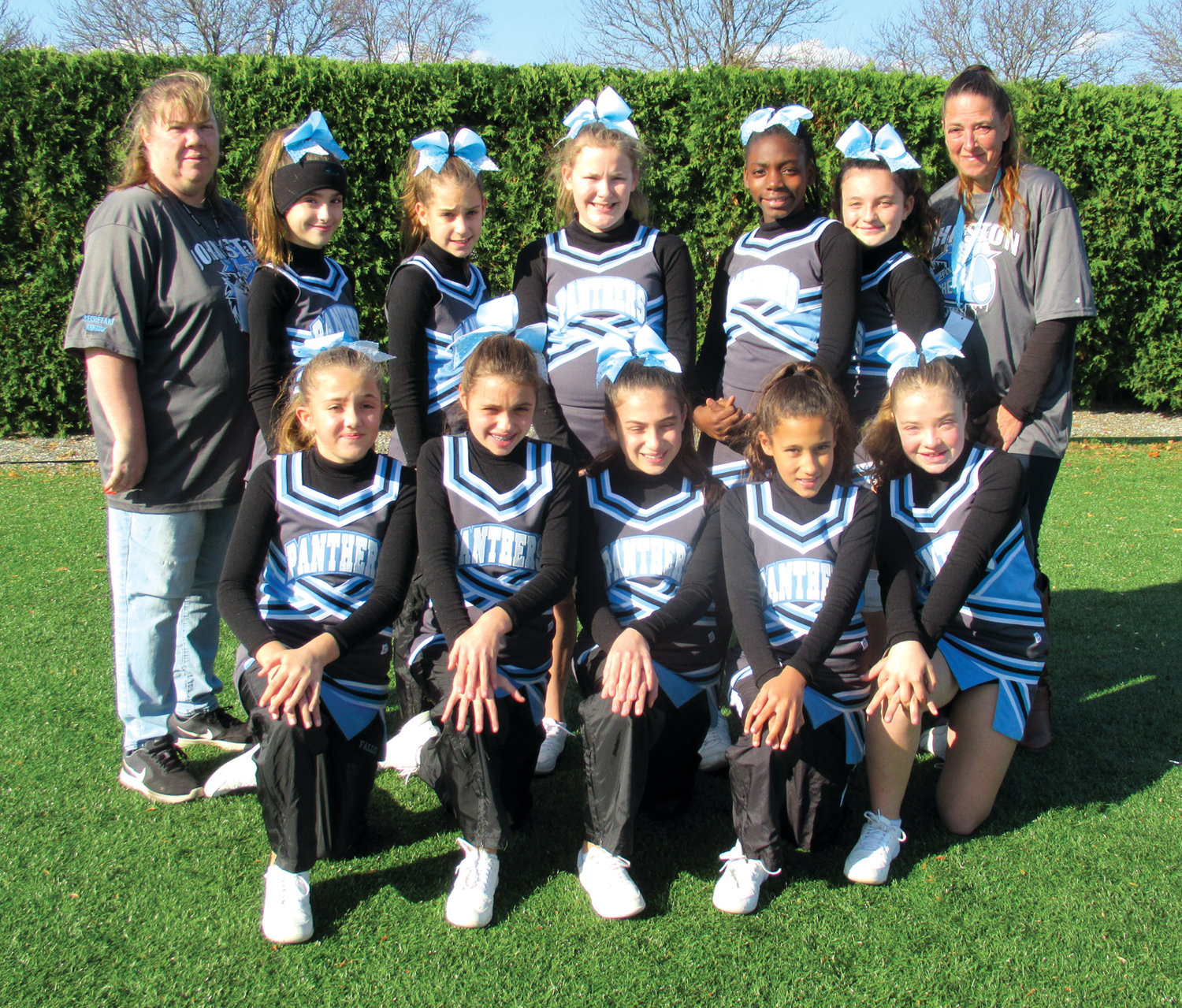 SPIRIT SQUAD: Among the young girls who cheered the U-12 Panthers on during the recently-completed football season are, in front from left: Fallon Davis, Isabella Senno,      Isabella DeVecchis, Sianna Molina and Chantelle Lacasse. Top: Head Coach Sherri Lyons, Alexa Delmonaco, Arianna Perron, Dakota Tomlin, I'Daizha Brown, Angelia Allard and Coach Penny Lewis.
