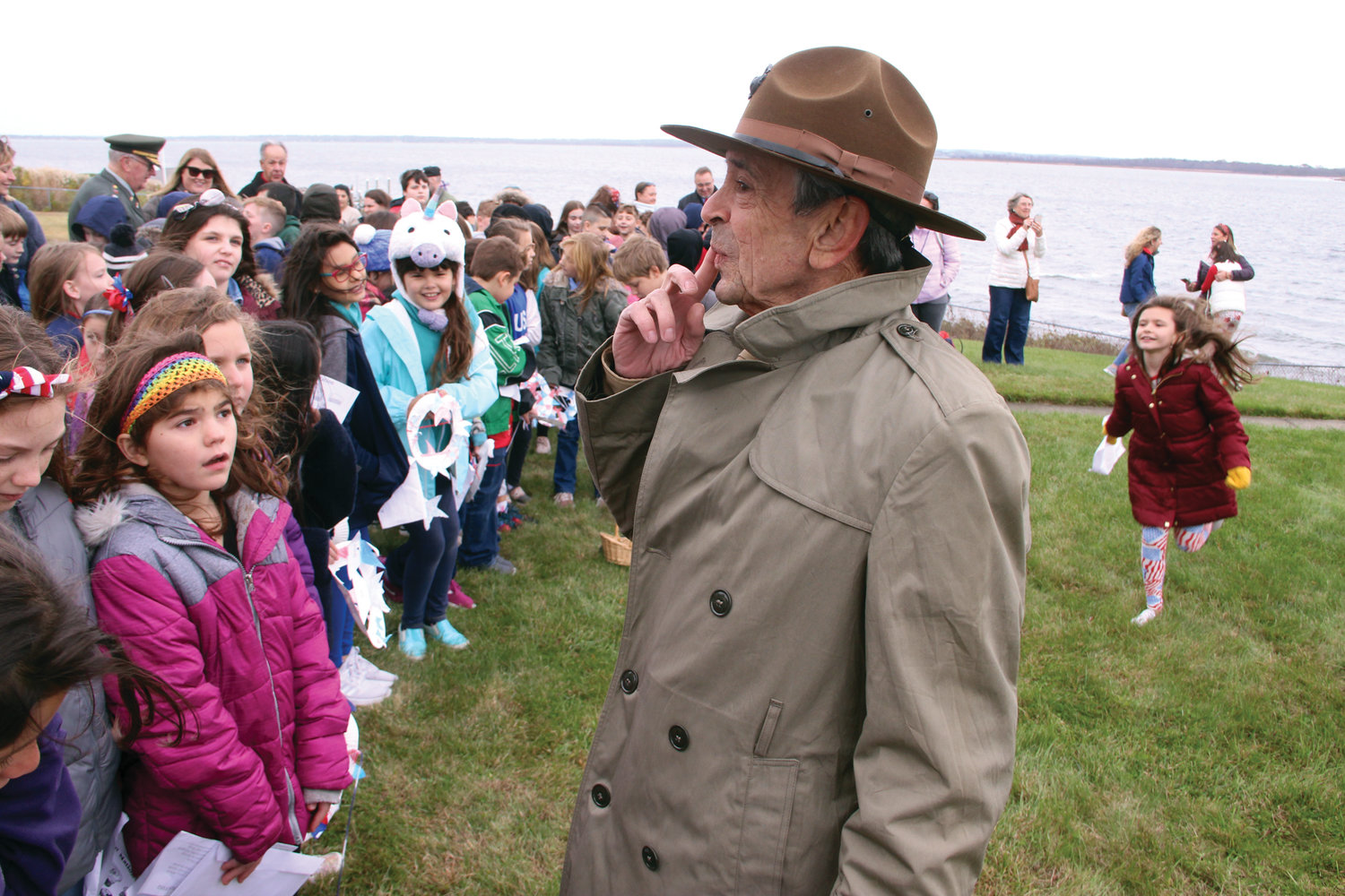 FACE-TO-FACE: At the conclusion of Thursday's ceremony at Warwick Neck Light, Warwick Neck School students had the opportunity to talk with veterans, including Robert Cutler, an Army veteran who served in Vietnam.