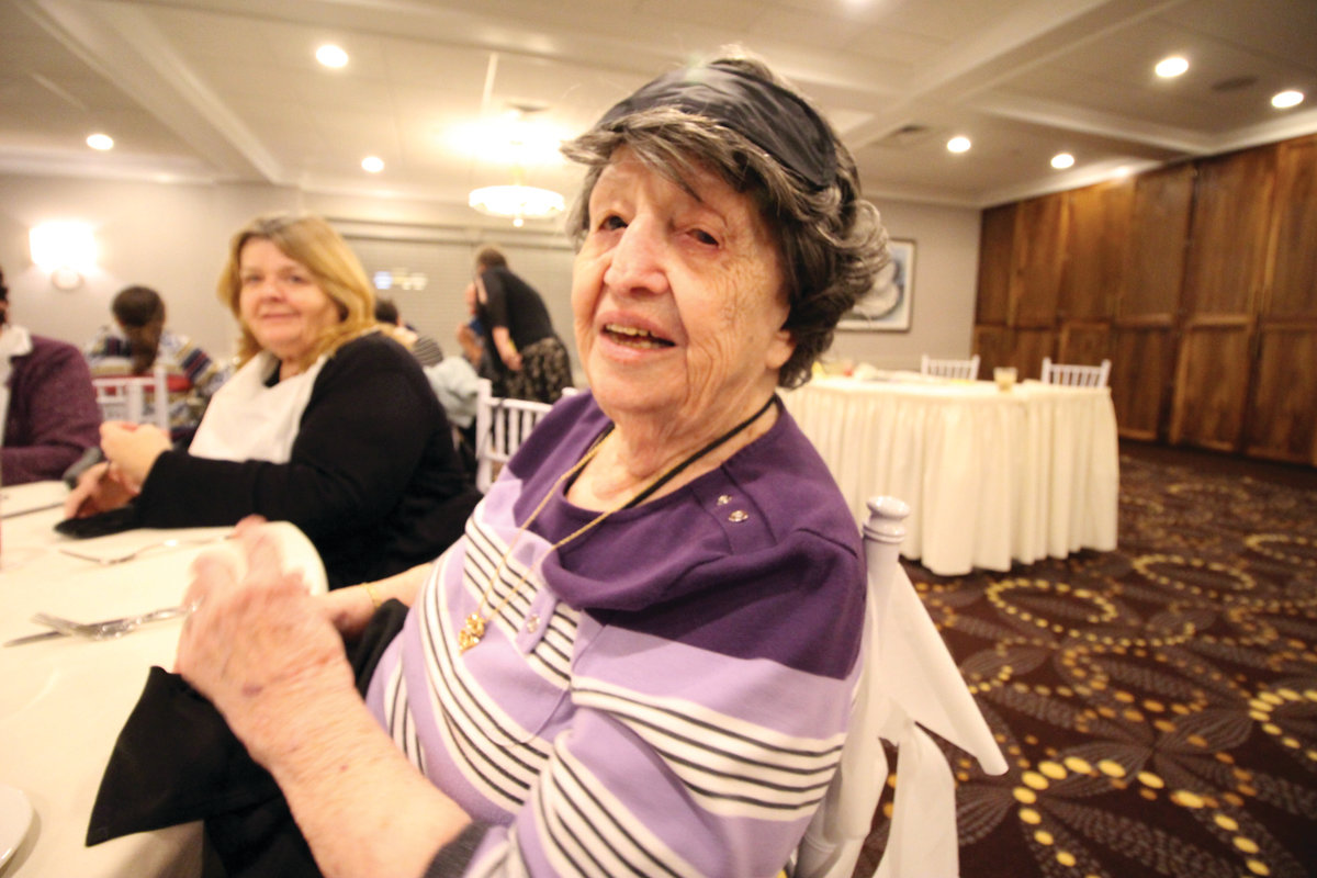 UNMASKED: Frances Amico, who is 104 years old, before sliding a mask over her eyes as other guests did at the Dining in the Dark event hosted Saturday by the Warwick Greater Lions Club.