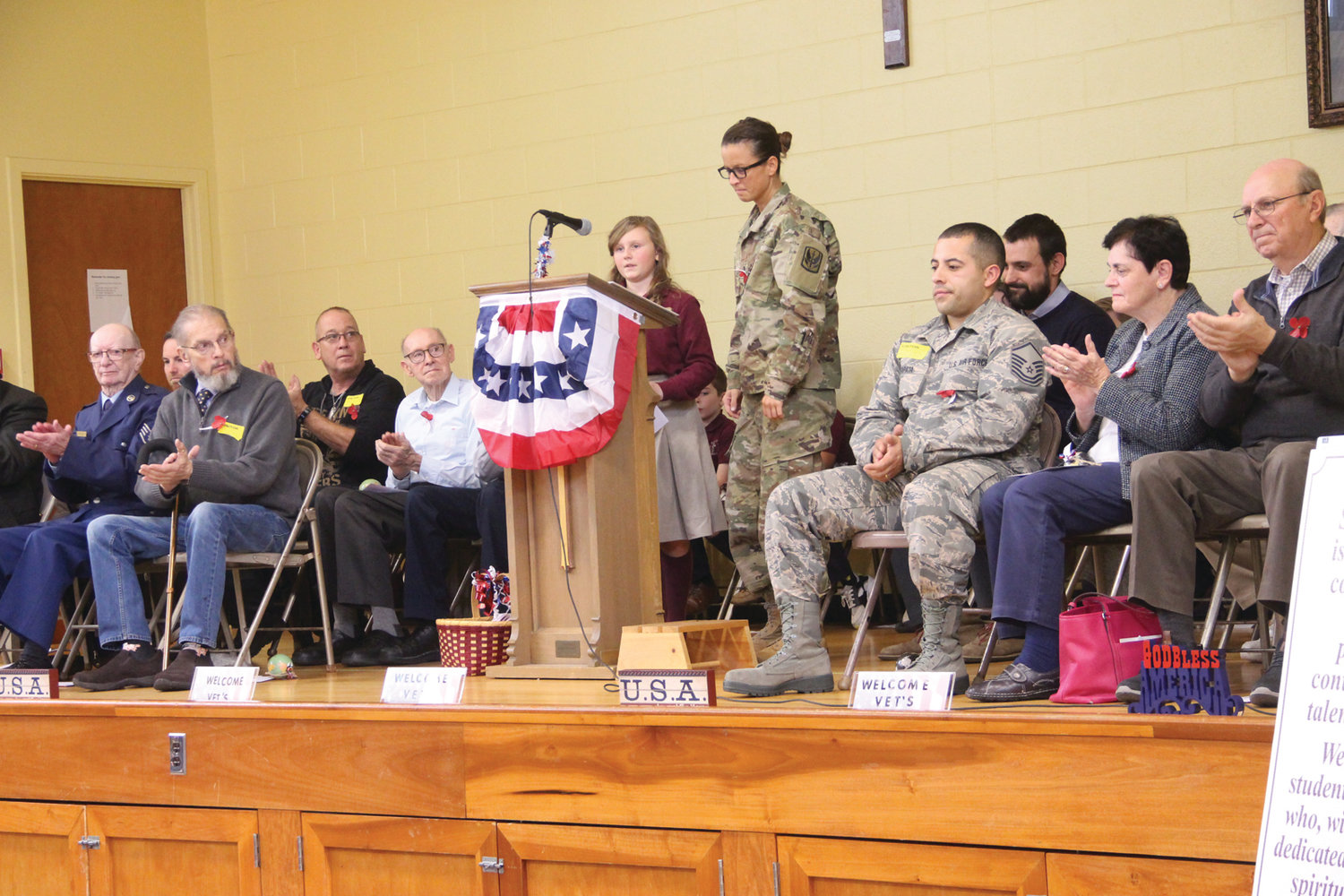 IN UNIFORM: Sixth grader Delilah Tully gave her cousin Lindsay Laurie who serves in the Army National Guard a token in appreciation of her talk. Students gave gifts to all the speakers.