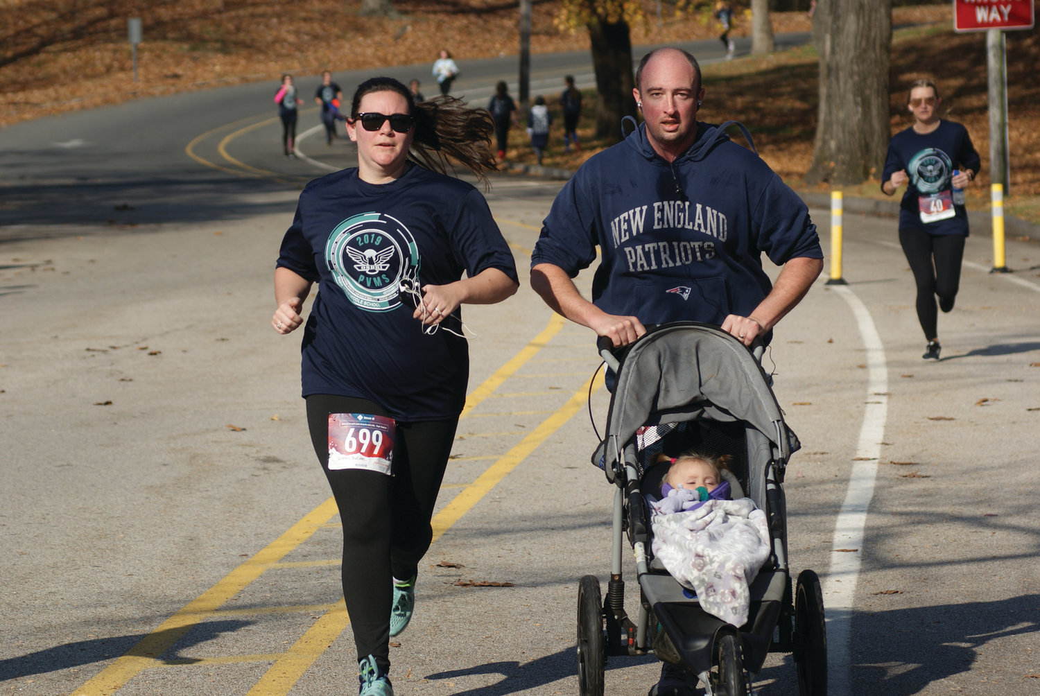 TAKING IT IN STRIDE: Matt and Lindsay Ryan of Warwick kept pace as they were joined by their daughter, 10-month-old Lillian. The family finished the course in just less than 40 minutes.