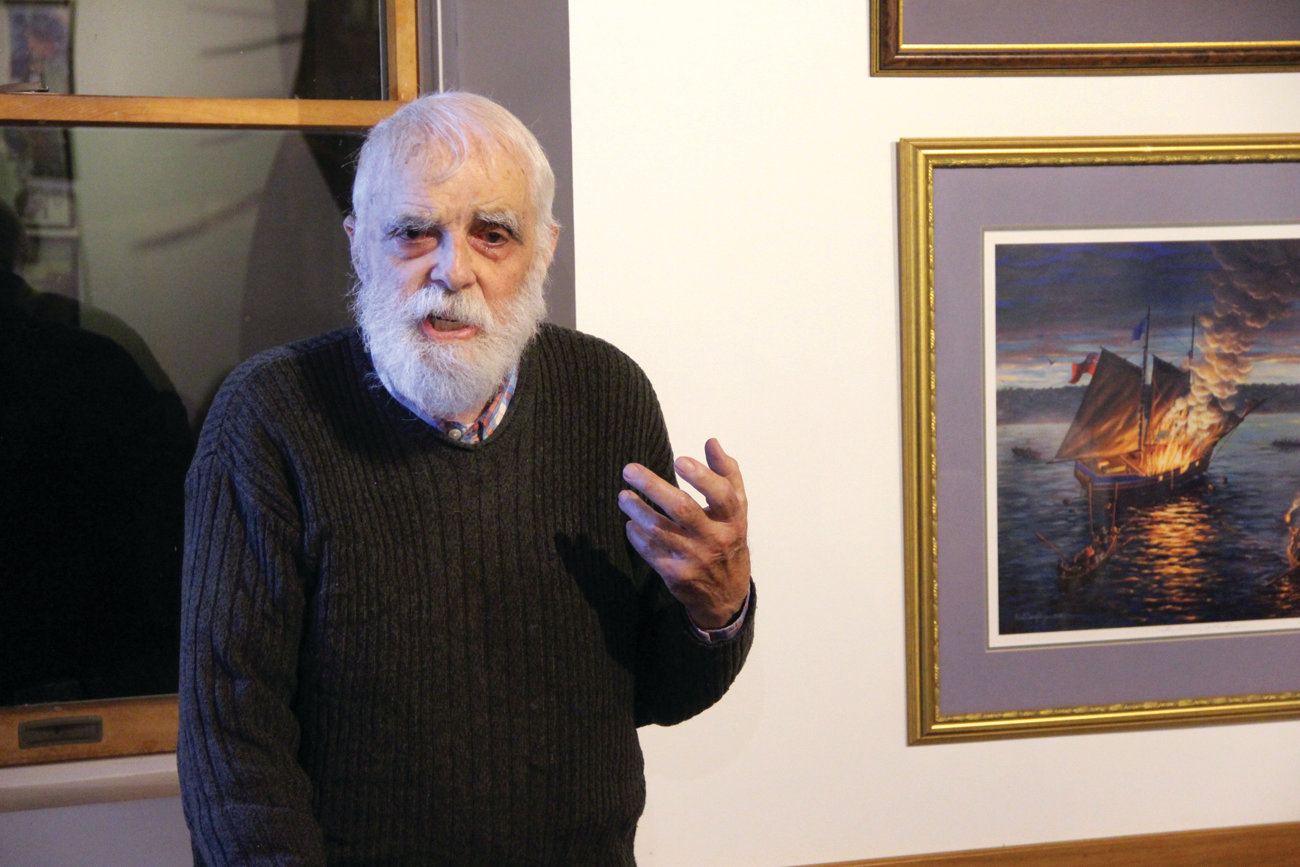 HE KNOWS THE STORIES: An author, historian and community activist on behalf of preservation and conservation, Henry Brown addressed members of the Pawtuxet Village Association Tuesday. Appropriately, he stands next to a painting of the burning of the British schooner Gaspee in 1772, which he has researched extensively.