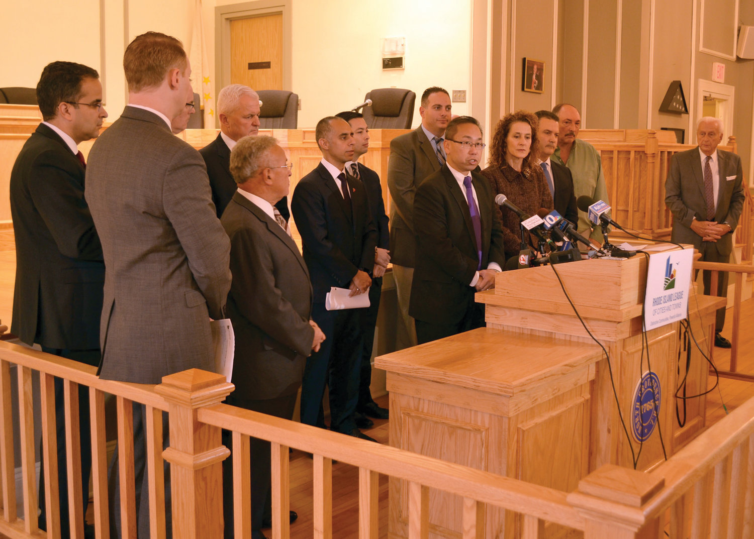 NOTABLE ABSENCE: Cranston Mayor Allan Fung speaks during a press conference at North Providence Town Hall Tuesday morning as 16 municipalities announced a lawsuit over the contract continuations bill passed this spring. Mayor Joseph Polisena, a staunch opponent of the bill since its inception, was not present and said later that the town would not be joining the suit in an effort to save taxpayer money.