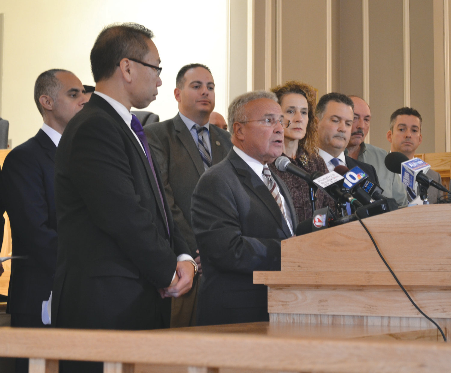 MAKING THEIR CASE: North Providence Mayor Charles Lombardi, who hosted the press conference, was among the local leaders who joined a lawsuit against the contract continuations bill on Tuesday.
