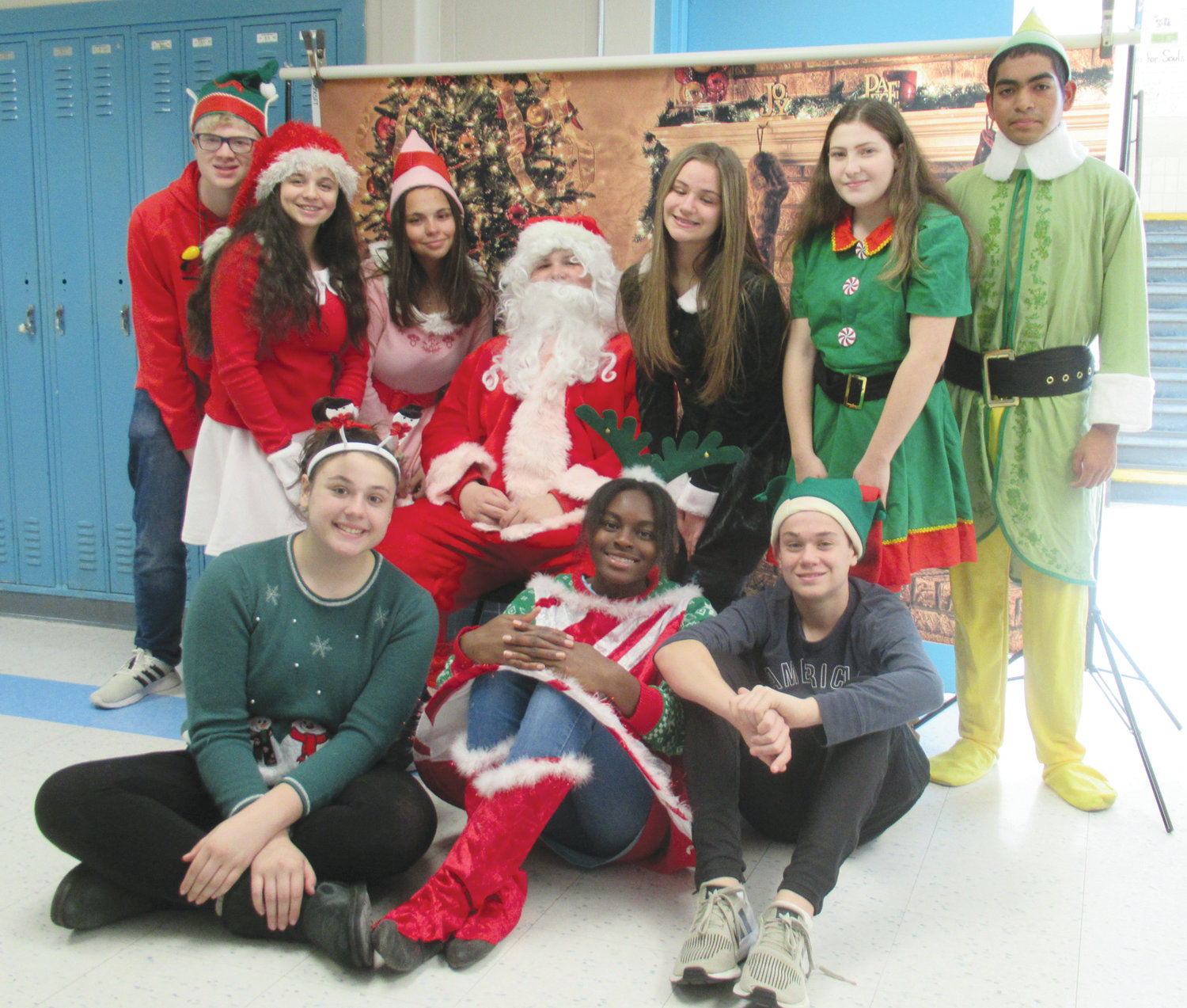 FANTASTIC FROSH: Members of the Johnston High School class of 2023 were all decked out in holiday garb to welcome Tyler Tomlin as Santa Claus. His helpers are, in front from left, Talia LaFlamme, Josephine Olagundoye and Jacob Muller; and top from left, Jackson Troxell, Hannah Calabro, Michelina King, Gianna Brodeur, Emily Feinstein and Joshua Galeas.