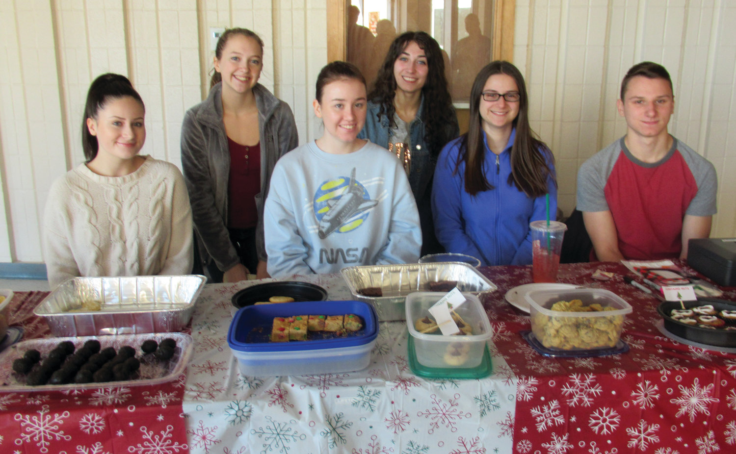 SUPER SENIORS: Students from the class of 2020 set up a special baked goods sale during Saturday's Holly Fair. The included Sarah Valentine, Michaela Healy, Jenni Aubin, Mia Ragosta, Allison Kane and Chris Flanagan.