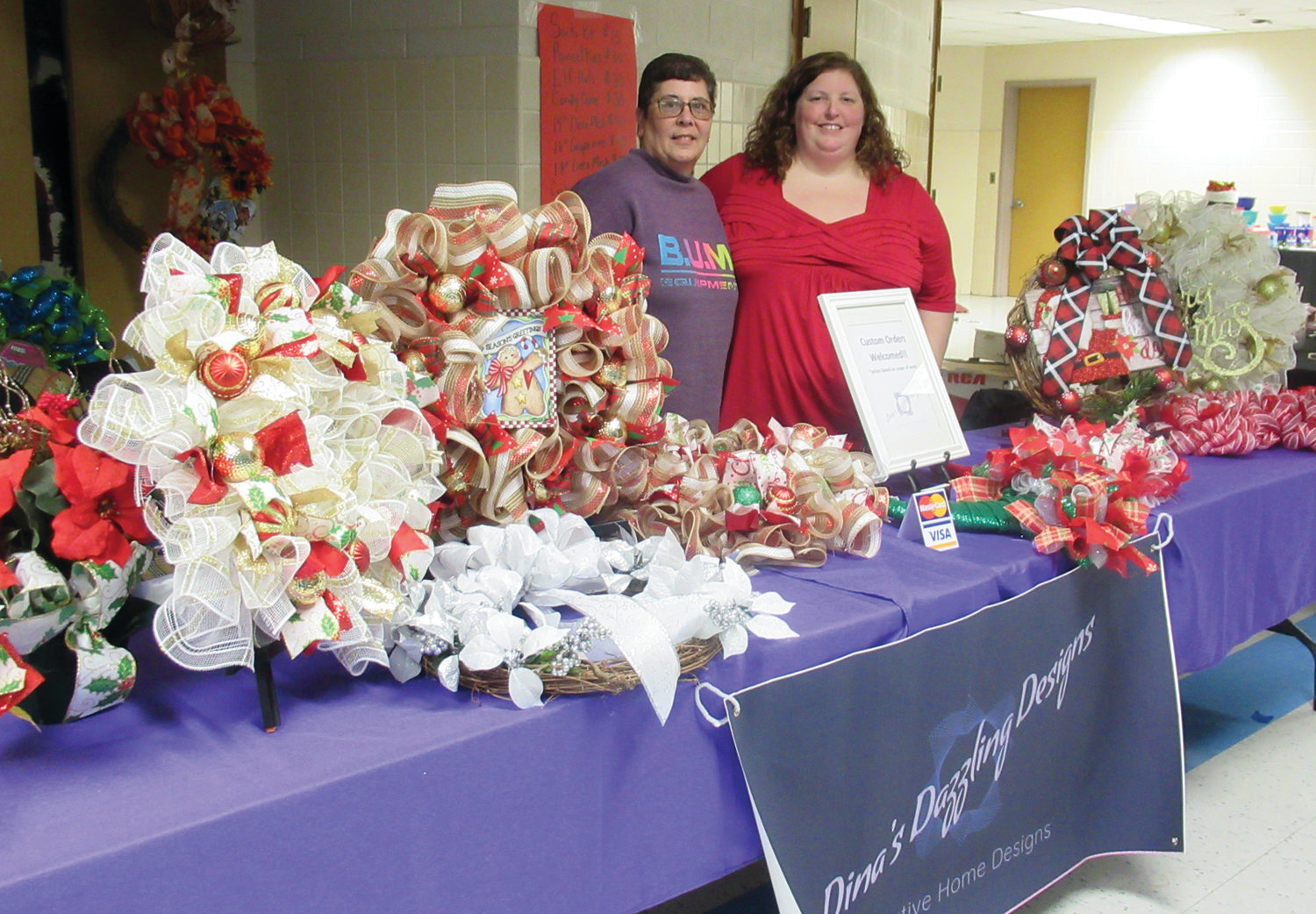 DINA'S DAZZLING DESIGNS: Dina and Kim Audette had quite the collection of specially made Christmas wreaths and decorations during Saturday's Holly Fair.