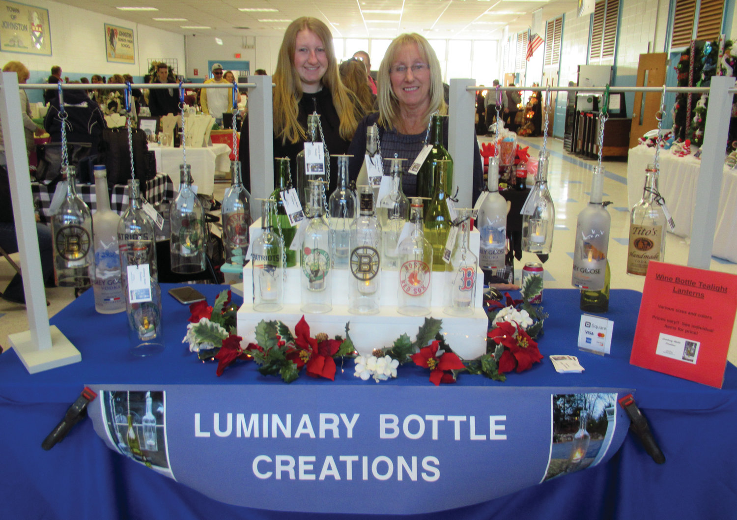CLASSIC CREATIONS: Debra and Rebecca stand behind the handmade luminary lights they make from scratch using various bottles.