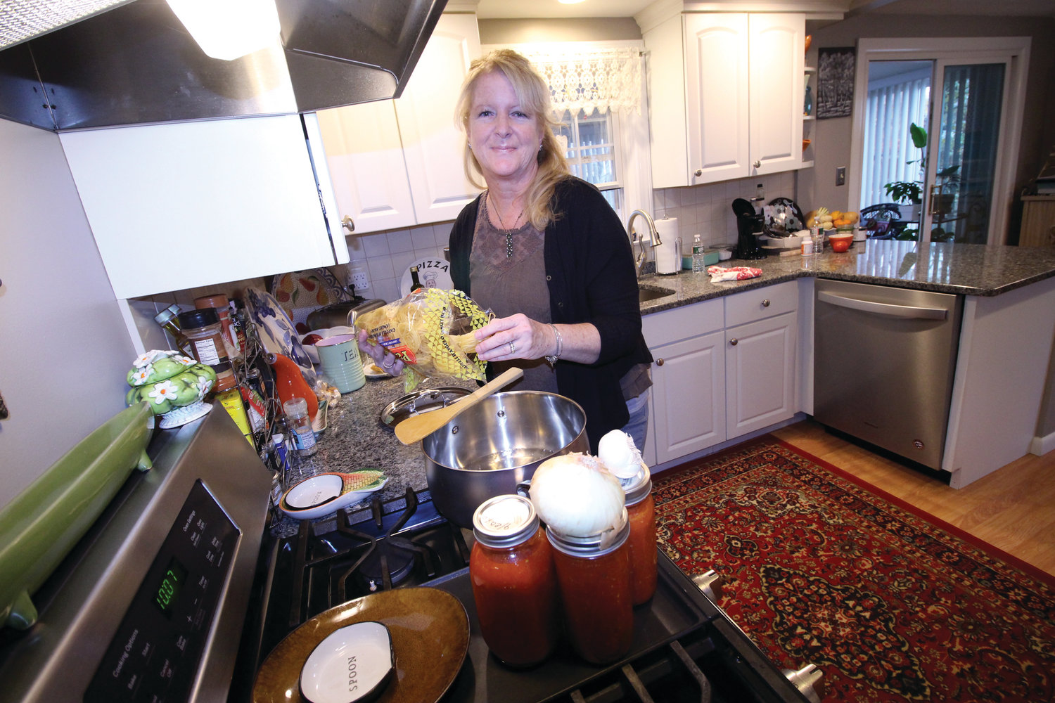 "CELEBRATING TRADITION: Janice Torilli, the force behind reviving the ""Local Flavor"" cookbook, enjoys cooking for her family and is passing on her love of cooking to her grandchildren by cooking with them whenever they get the chance."