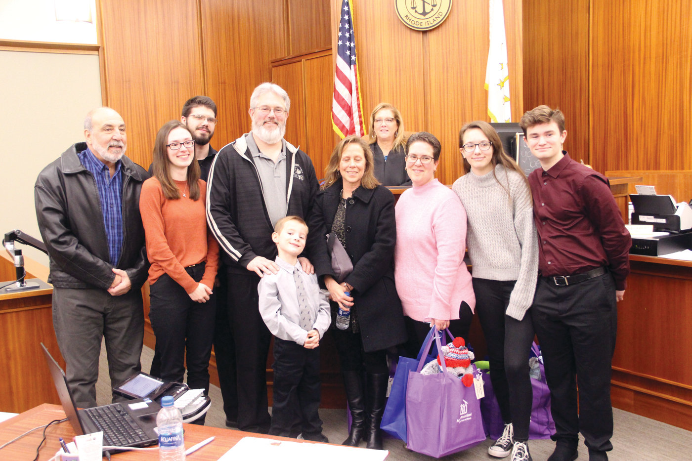 HAPPY MOMENT: The extended Fielder family joins Judge Karen Lynch for a group photo following the formalization of Noah's adoption.