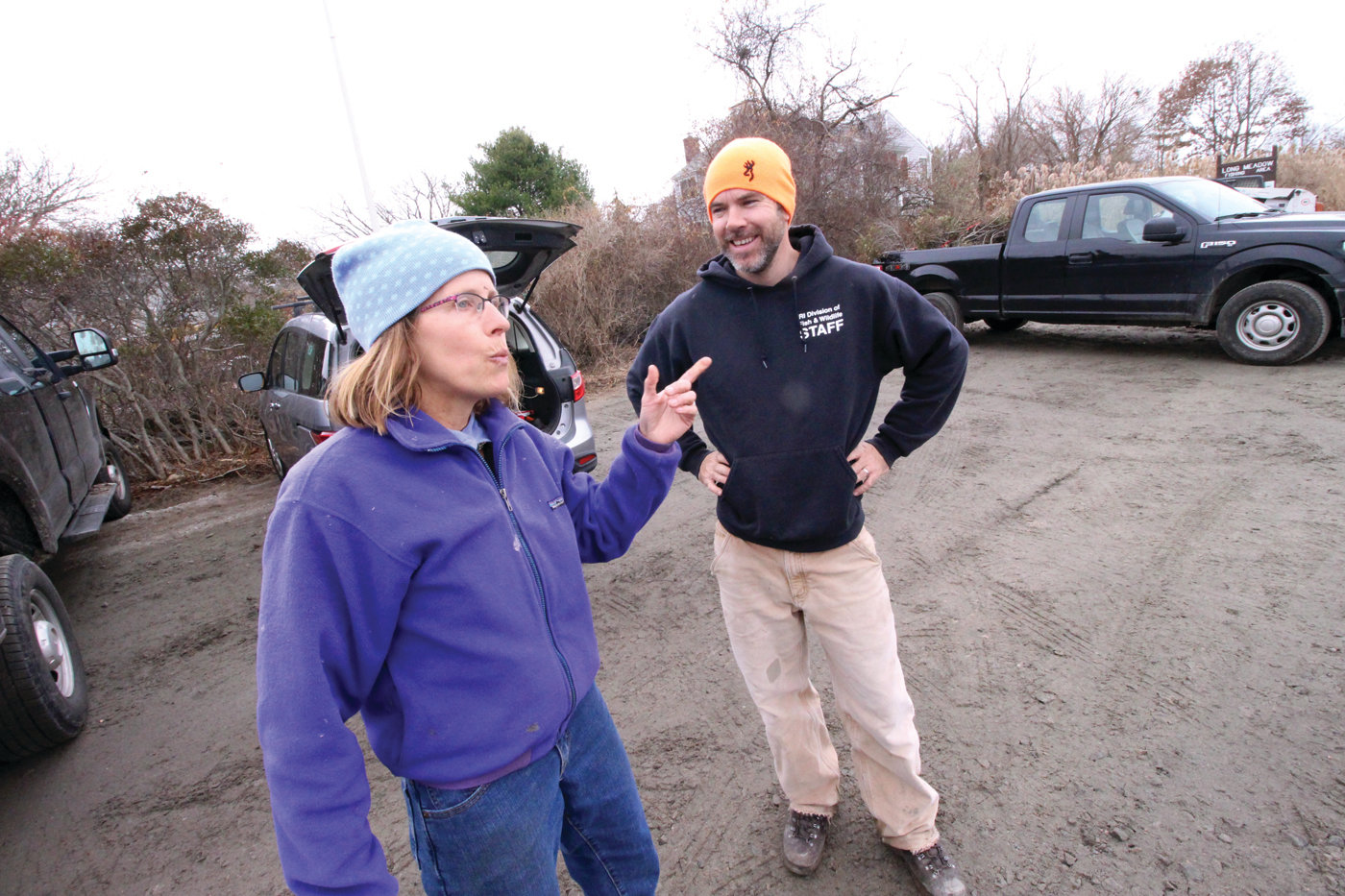 OVERSEEING THE PROJECT: Wenley Ferguson, restoration coordinator for Save The Bay, and DEM Division of Fish & Wildlife biologist Tanner Steeves look over the nearly completed Longmeadow fishing are Friday.