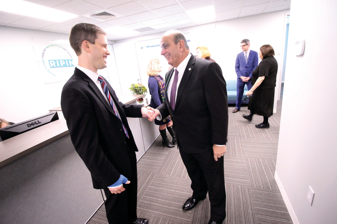 WARWICK WELCOME: Mayor Joseph Solomon and RIPIN Executive Director Samuel Salganik chat at Monday's event celebrating the agency's move to Warwick.