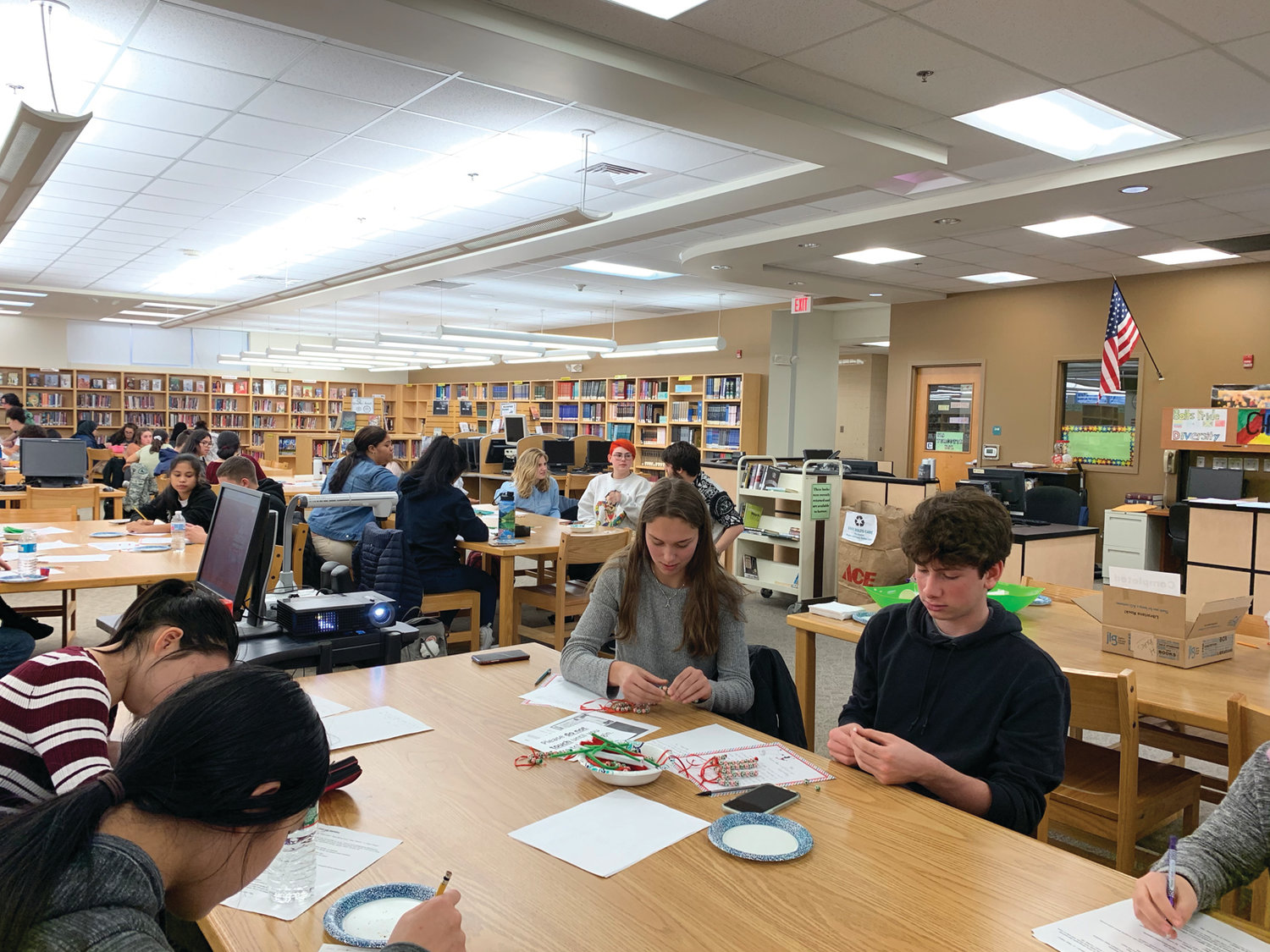 CRANSTON EAST ELVES: Students from Cranston East recently took time to write letters and make ornaments for U.S. veterans. The items will be distributed by Operation Rhody.