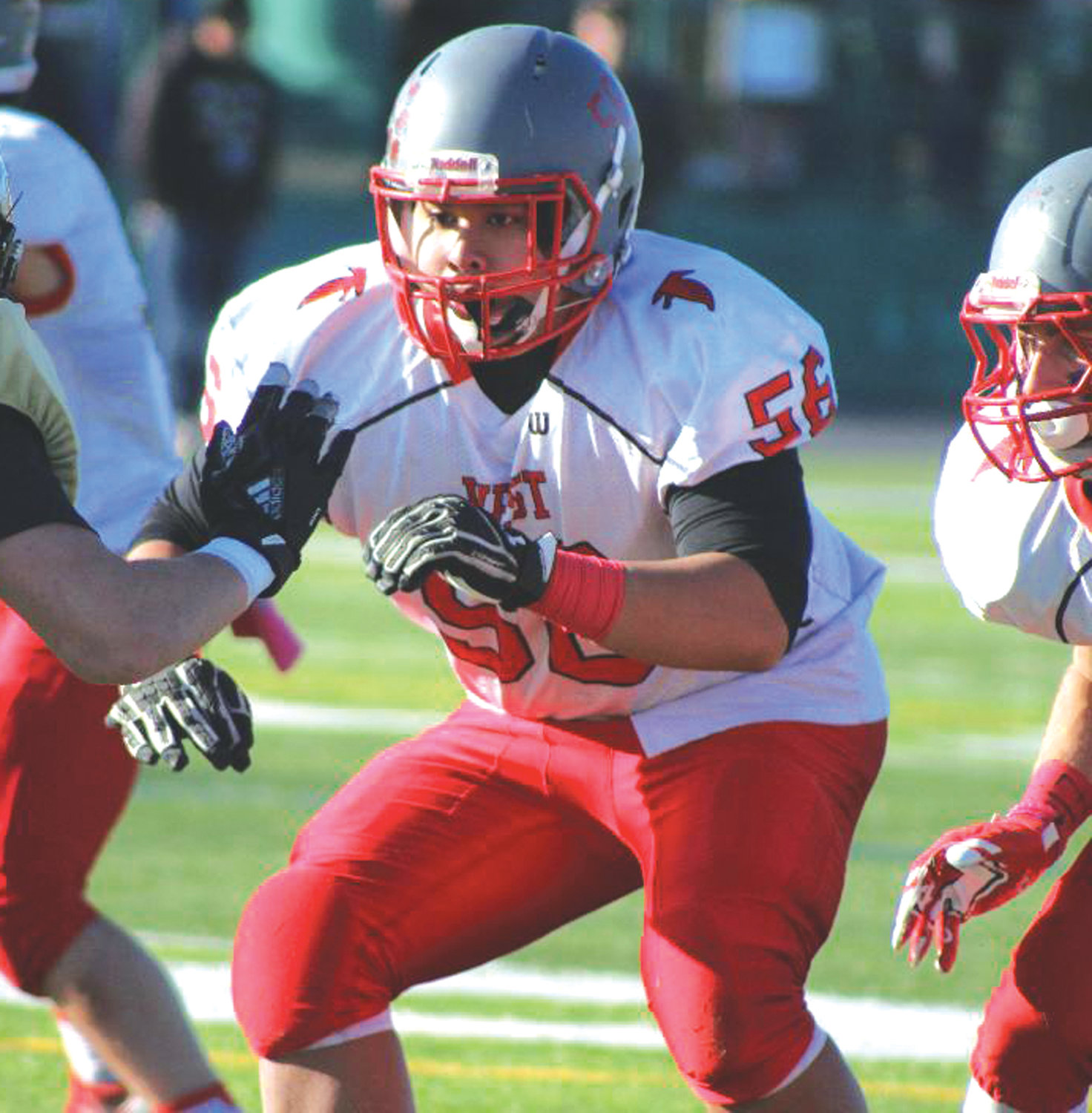 PROTECT THE HOUSE: Cranston West offensive lineman Miccolo De La Rosa (56) during the Super Bowl against North Kingstown.