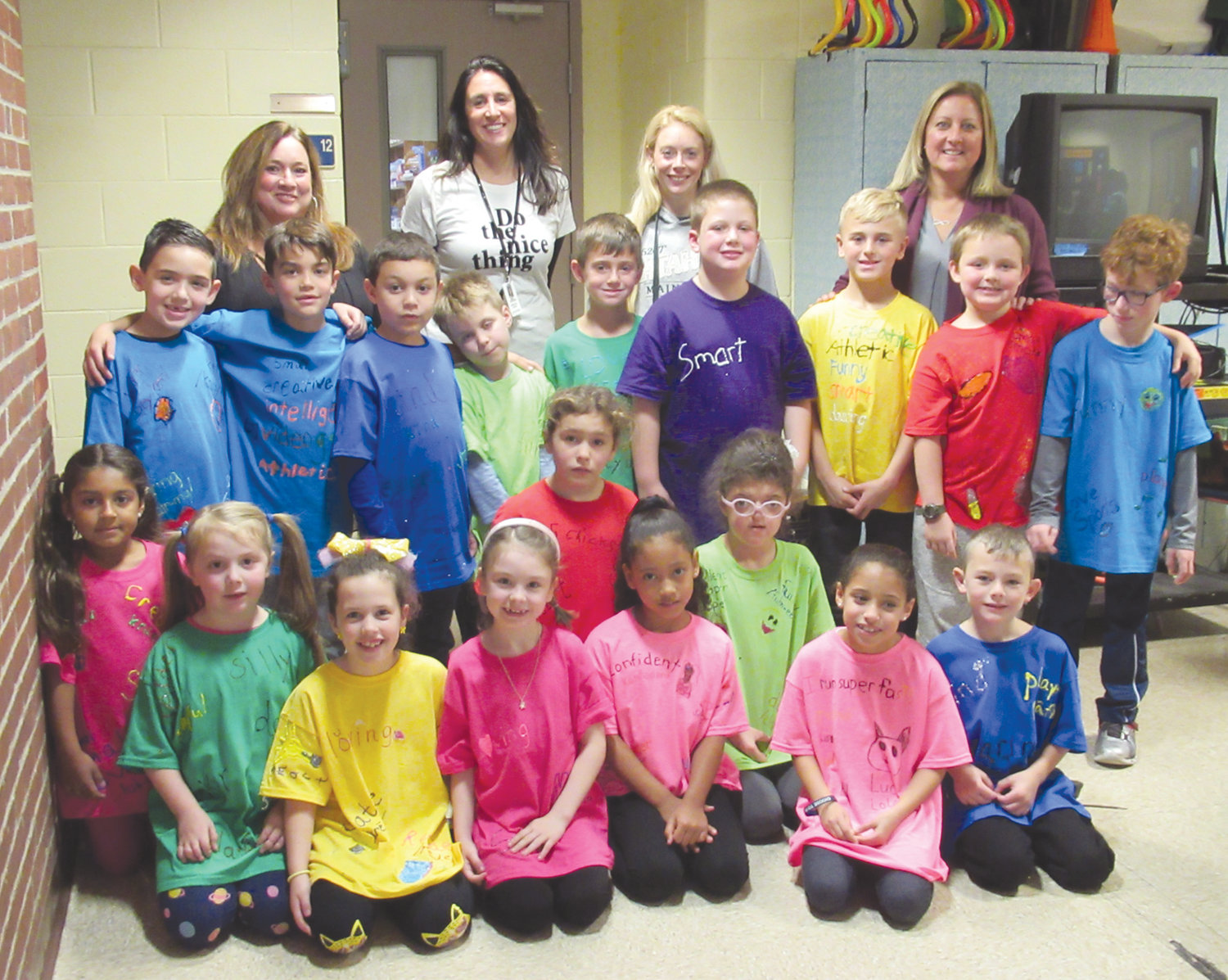 POPULAR PAINTERS: These are the Winsor Hill Elementary School students who painted special slogans on their T-shirts during recent art enrichment program. They're backed by teachers Kerri Yekelchik, Dina Needham, Kim Marshall and Susan Parillo.