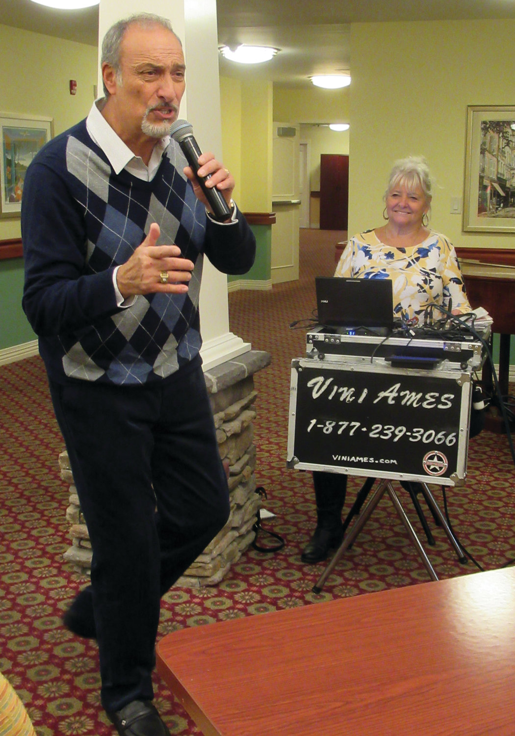 "MIGHTY MUSIC: Vini Ames sings one his many old-time favorites – Frank Sinatra's ""Summer Wind"" – during the annual black Friday Party at Briarcliffe Gardens."
