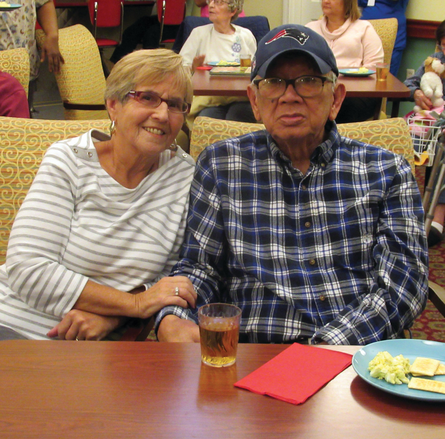 CLASSIC COUPLE: Cathy and Hector Lipa, who once owned and operated a catering business, enjoy the music of Vini Ames – who just so happened to sing at their golden anniversary party three years ago – during the Black Friday Party in Johnston.