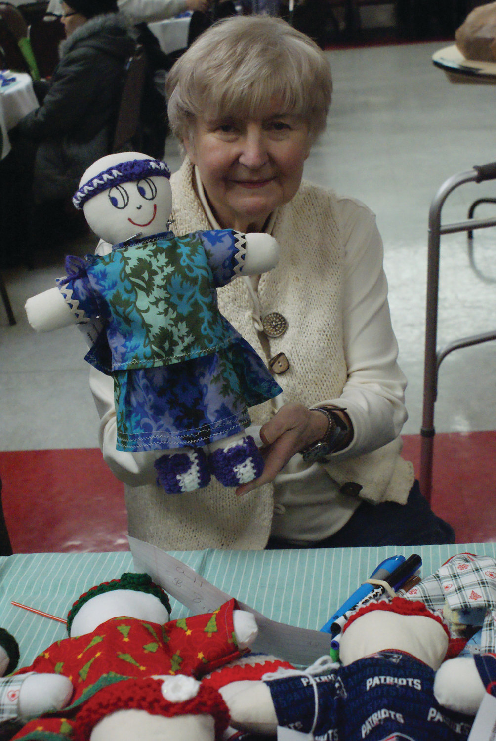 FINDING A SMILE: The Smile Dolls generally come with no faces so that children can draw their own, although a smile can be requested. Pictured is Peggy Gale, 84, a former art teacher and volunteer for the Smile Dolls Program.