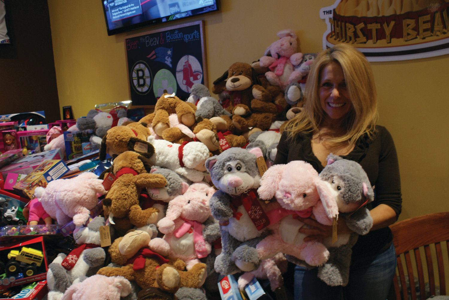 TEDDY BEARS: Donating 500 teddy bears to the effort was Elizabeth Winnes, owner of Release The Reins.
