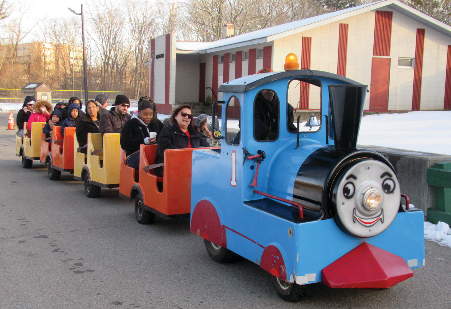 ALL ABOARD: That's the chant Jim Olson issued Saturday as he drove the famed Okee's Amusements train around Johnston War Memorial Park during the annual Holiday Festival.