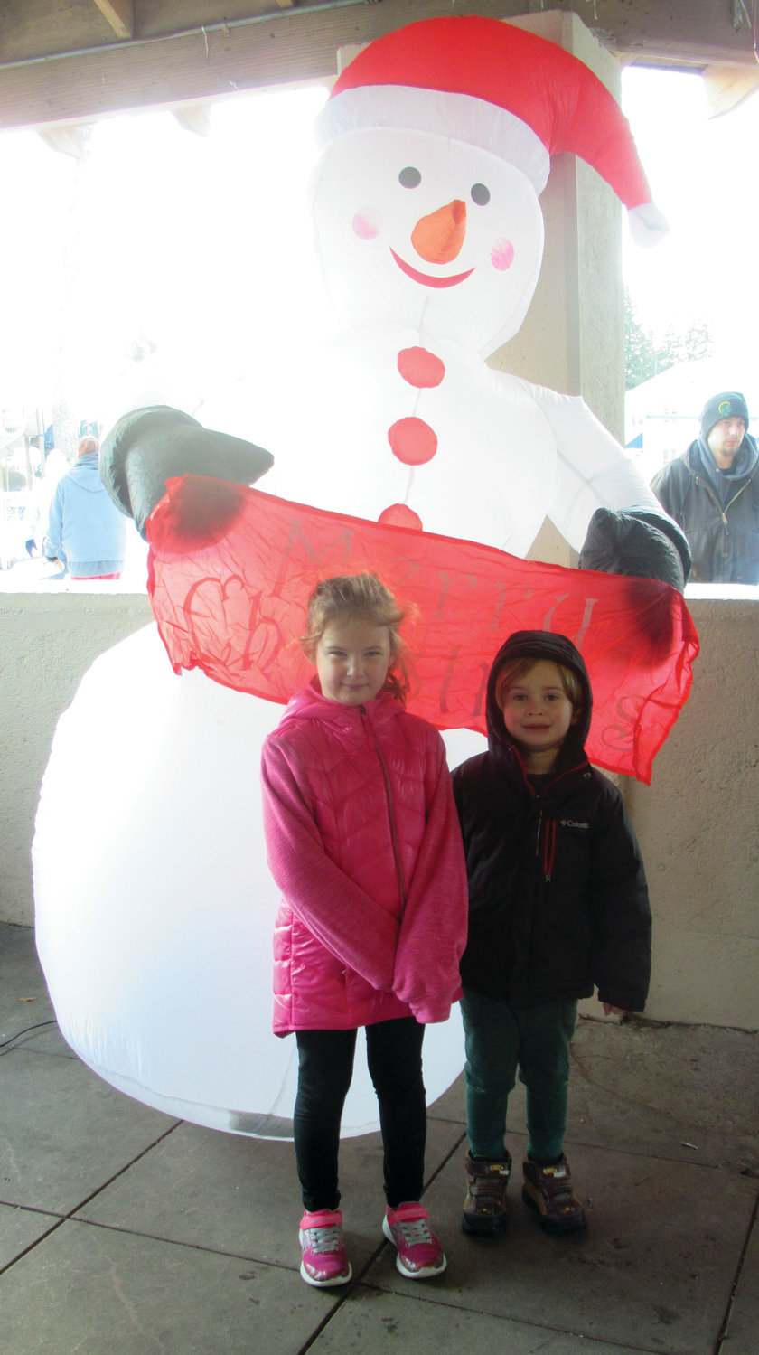 FROSTY'S FRIENDS: Children like Callie Crete, 9, and her brother Caleb Crete, 4, enjoyed having their pictures taken with this inflated snowman during Saturday's annual Holiday Festival.