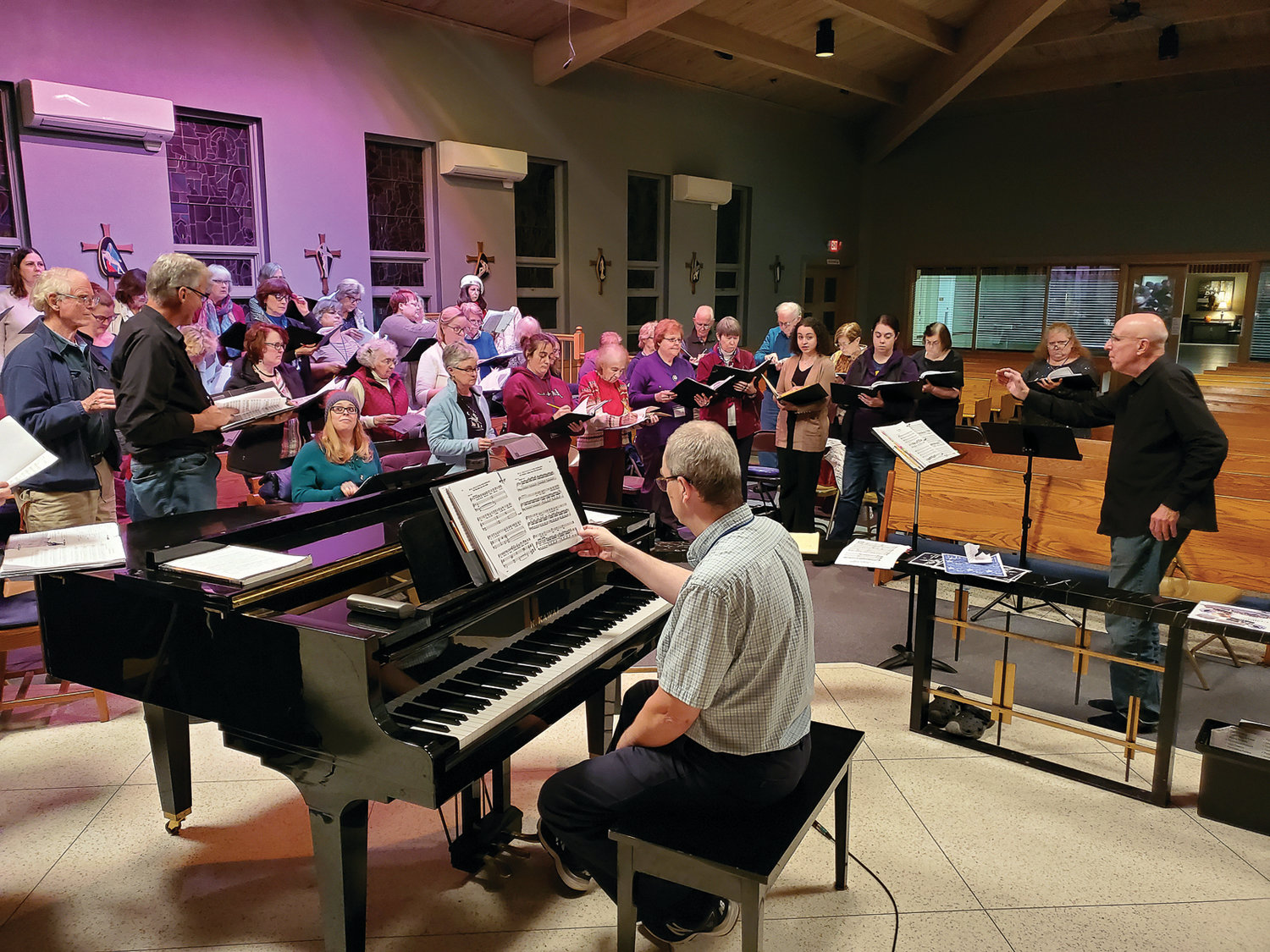 "40 YEARS IN THE MAKING: The West Bay Chorale rehearses for ""Welcome Yule!"" at St. Kevin Church in Warwick, taking place Dec. 15, under the artistic direction of Eric Van Dervort."