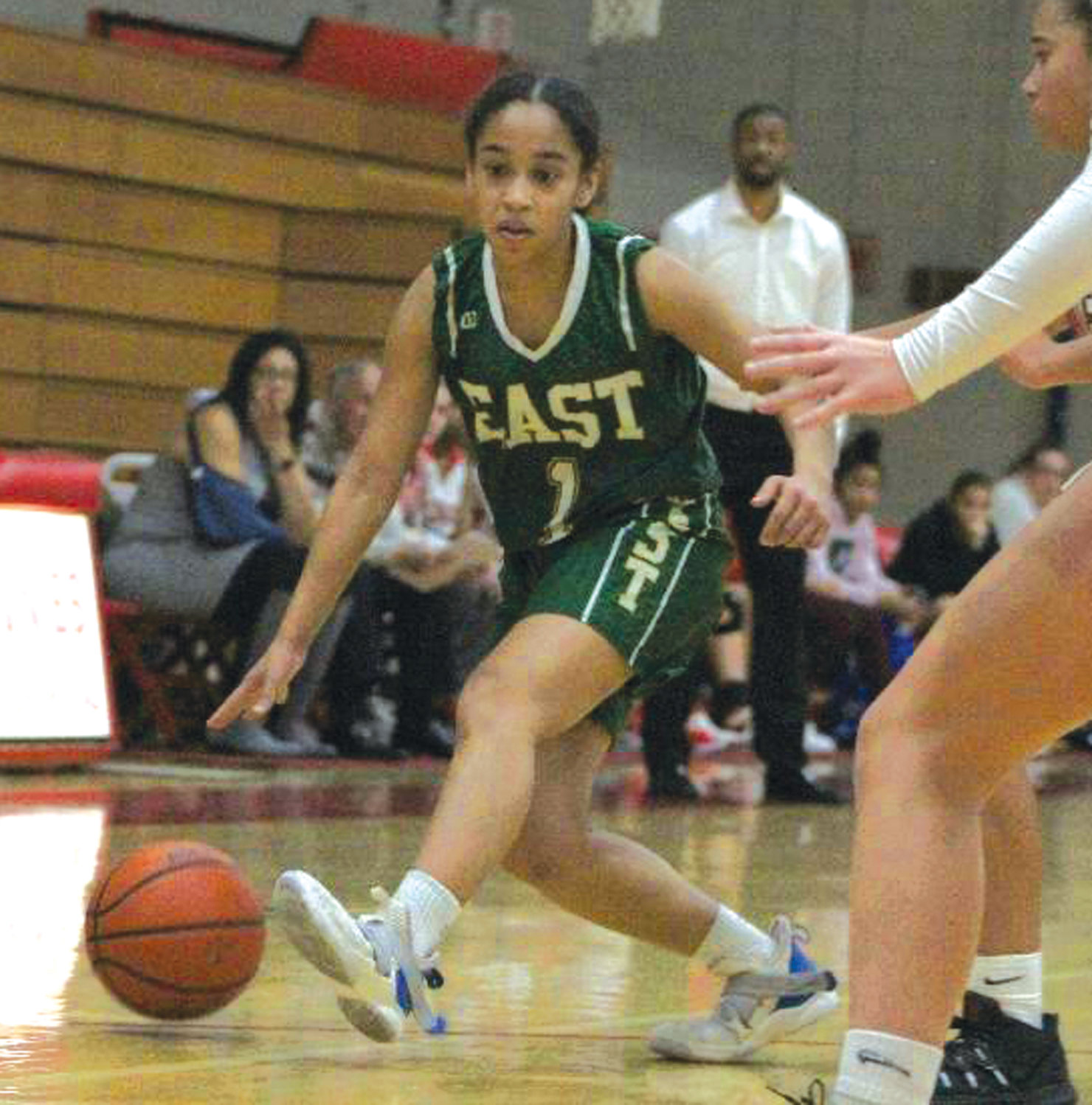 LOOKING FOR SPACE: Cranston East girls basketball player Thamia Perez looks for space to work against East Providence during the teams' season opener on Monday evening at EP. The Townies sunk a buzzer-beater to wrap up the 41-39 win and hand the Thunderbolts their first loss of the season.