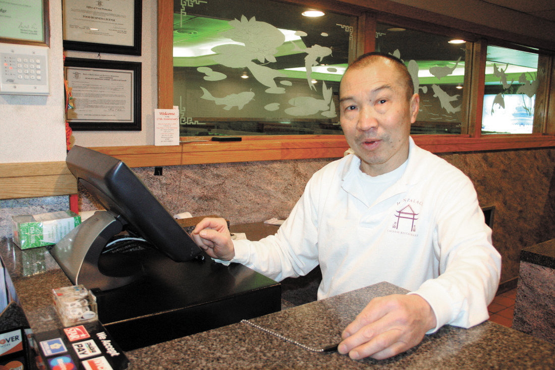 "A TRADITION: Keith Lau, co-owner and manager of Han Palace in Warwick, said the holidays are a busy time of year for the restaurant. ""The Han Palace regulars have made coming here to eat as their tradition even when it's extremely busy here,"" he said. ""Christmas is a special holiday for us. It should be for everybody."""
