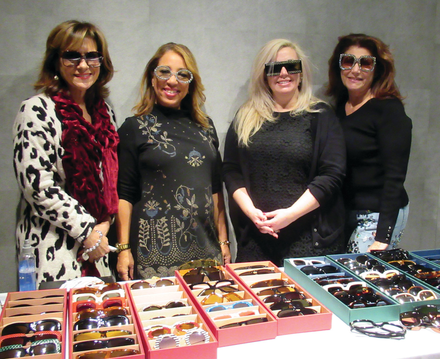 "GUCCI GIRLS: Gucci representative Suzette (second left) and ladies like Cynthia Parker, Lynne Diamante and Deb Crossley model the latest look in eye fashion during the recent ""Shop for a Cause"" in Johnston that was the first event of its kind in New England."
