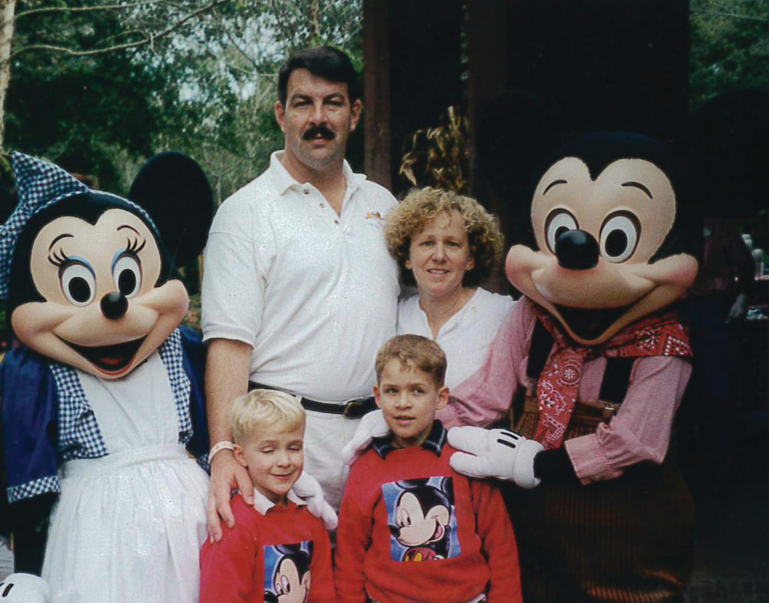 BONDED BY LOVE: Vince, Nancy, Nick and Ben Haight gather together during a family trip to Disney World in this photo provided by Nancy. The family has advocated for greater funding for childhood cancer research.